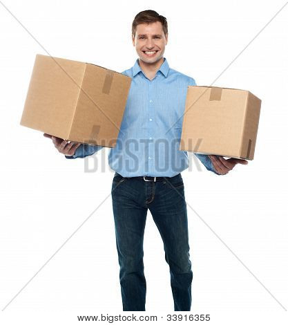 Portrait Of A Guy Holding Boxes