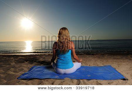 Meditating On Beach With Sunrise