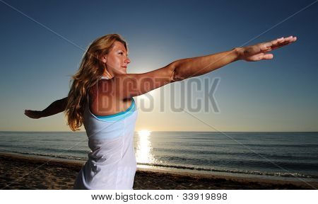 Woman Doing Warrior Pose Ii (virabhadrasana Ii)