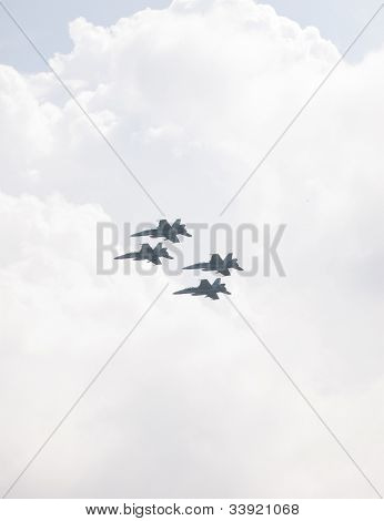 HOBOKEN, NJ - MAY 23: Four military FA-18G aircraft fly along the Hudson River near Manhattan during the Parade of Sails on May 23, 2012 in Hoboken, NJ. The parade marks the beginning of Fleet Week.