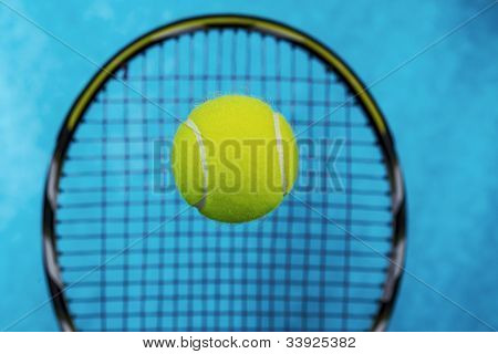 Tennis Ball In Front Of Racket