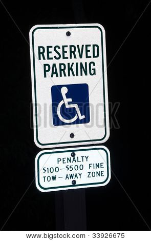 Reserved Parking Sign For Disabled At Night