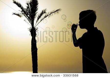 Boy Playing With Soap Bubbles