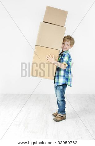 Boy Holding Pyramid Of Carton Boxes. Packing Up To Move