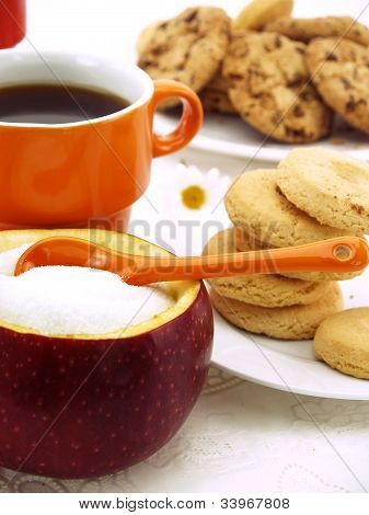 Sugar Bowl Made Of Red Apple With Fructose Inside, Set On Table With Coffee And Cookies