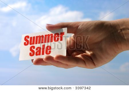 Female Hand Holding Sale Card