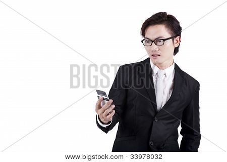 Shocked Businessman Reading Message