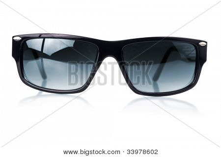 Modern dark sunglasses with a black frame  on a white background with reflections