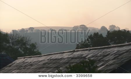 Welsh Dawn In Countryside Over Rooftop