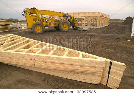 Construction Site With Trusses and Front-End Loader