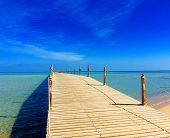 Wooden Empty Terrace Dock Or Pier. Wooden Dock Pier Blue Sea & Sky Background. View Of Wooden Dock I poster