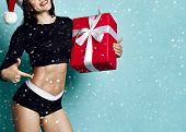 Closeup Of Athletic Fitness Woman With Perfect Body In Sportswear And Christmas Cap Holding New Year poster