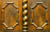 Decorative Wooden Elements Of Old Vintage Brown Furniture. A Curly Baguette On An Oak Cupboard Door  poster