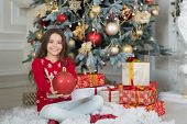 Decorating Christmas Tree. Christmas Tree Ball Selective Focus. Red Ball In Hands Of Happy Girl. Chr poster