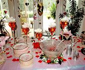 stock photo of punchbowl  - nicely decorated bridal shower table with rose plates and beautiful centerpieces - JPG