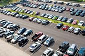 foto of parking lot  - Cars parked in rows at a parking facility in summer - JPG