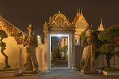 Wat Phra Chetuphon Or Wat Pho, A Buddhist Temple Illuminated At Night In Bangkok City, Thailand. Tha poster