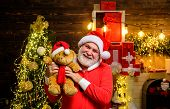 Smiling Santa Claus Holds Teddy Bear. Santa Claus Holds Plush Toy. Christmas Decoration. Merry Chris poster
