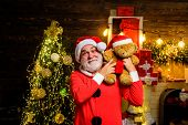 Santa Claus Holds Teddy Bear. Santa Claus Holds Plush Toy. Christmas Decoration. Merry Christmas. Ch poster