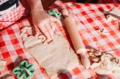 Kid Making Ginger Cookies For Christmas. Making Shapes In Dough With Dough Shaper poster
