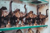 Bronze Brass Elephant Statues For Sale In Old Delhi. Selective Focus On One Statue poster