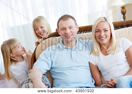 Happy parents not knowing their daughters being in shot too