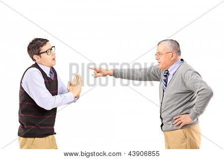 Young man begging and angry mature man gesturing with finger isolated on white background