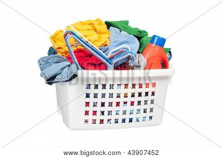 A laundry basket full of dirty clothing, clothes hangers and laundry detergent.  Isolated on white for designer convenience.