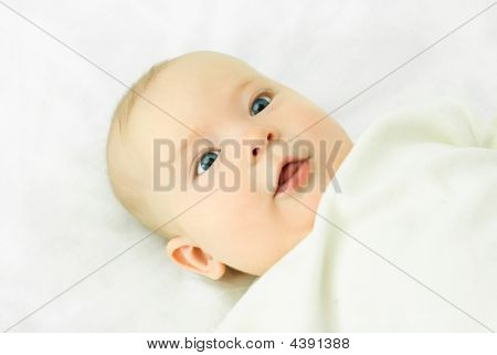 Cute Four Months Old Baby With Blue Eyes