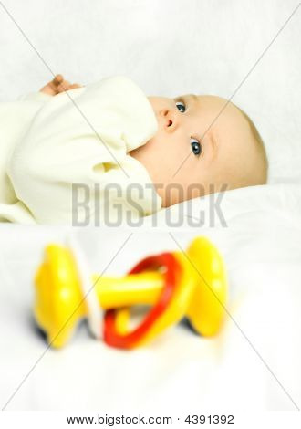 Cute Baby On The Bed With A Toy (focus On The Baby)