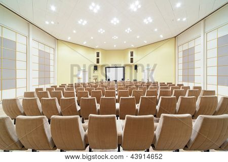 empty conference hall, design in white, yellow and beige
