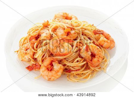 Pasta with tomato sauce and shrimps isolated on white background