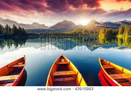 Mountain lake in National Park High Tatra. Dramatic overcrast sky. Strbske pleso, Slovakia, Europe.  poster