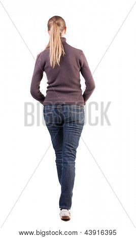 back view walking woman. beautiful blonde girl in motion. backside view person. Rear view people collection. Isolated over white hands folded on his stomach blonde in warm clothing goes ahead