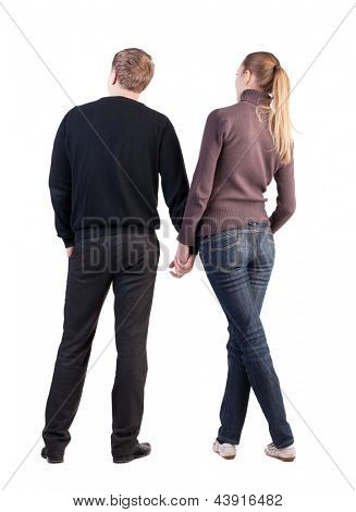 Back view of young couple (man and woman) look into the distance. beautiful friendly girl and guy together. Rear view. Isolated over white. opinionated pair interested considering something right