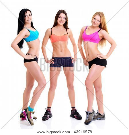 Three Graces - fitness girls, portrait of sport young women with perfect bodies, studio shot over white