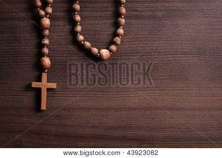 cross over brown wooden background