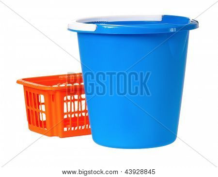Plastic blue bucket and orange basket, isolated on white background
