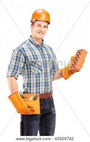 Male construction worker with helmet holding a brick isolated on white background
