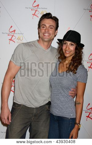 LOS ANGELES - MAR 26:  Daniel Goddard, Christel Khalil attend the 40th Anniversary of the Young and the Restless Celebration at the CBS Television City on March 26, 2013 in Los Angeles, CA