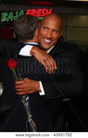 LOS ANGELES - MAR 28:  Dwayne Johnson arrives at the