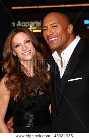 LOS ANGELES - MAR 28:  Lauren Hashian, Dwayne Johnson arrives at the