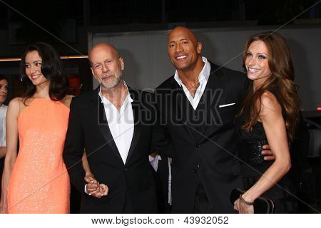 LOS ANGELES - MAR 28:  Emma Heming, Bruce Willis, Dwayne Johnson, Lauren Hashian arrives at the