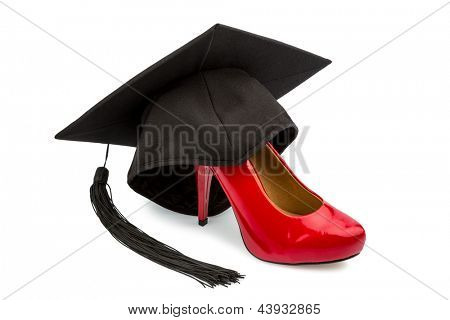 a red ladies shoes on a mortarboard, symbol photo for gender equality and women power