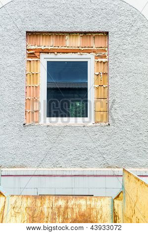 in an old new windows are installed to save on heating costs. renovation of old houses and sanieung