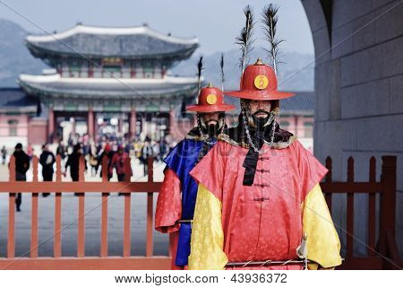 SEOUL - FEBRUARY 14: Guards at Gwanghwamun Gate, the entrance of Gyeongbokgung Palace February 14, 2013 in Seoul, ROK. Guards have been placed at the palace, once home of the king, since the 14th C.