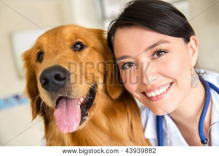 Portrait of a female vet with a cute dog