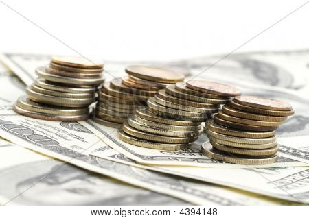 Closeup Photo Of Stacks Coins Over Dollars
