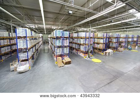 MOSCOW - JUNE 5: Warehouse with rows of shelves at Caparol factory on June 5, 2012 in Moscow, Russia. Caparol company has 10 branches in Russia.