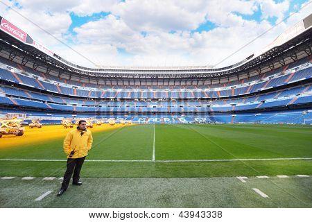 MADRID - MARCH 8: Worker serving Santiago Bernabeu stadium on March 8, 2012 in Madrid, Spain. Stadium was built in 1947, is named after mud Real Madrid president Santiago Bernabeu.